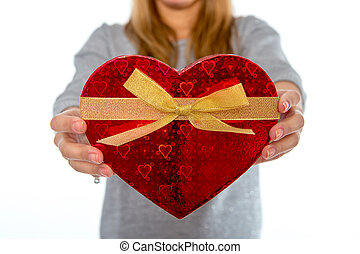 woman holding a love heart box on white background