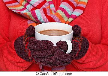 Woman holding a mug of hot chocolate - Close up midriff ...