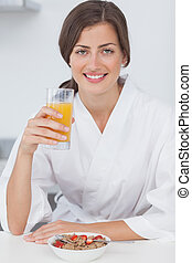 Woman holding a orange juice glass