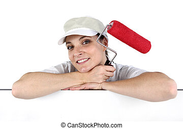 Woman holding a paint roller