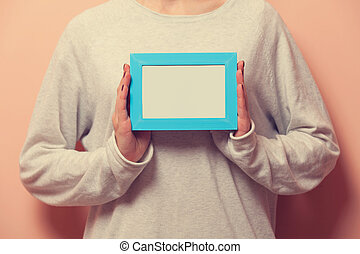 Woman holding a photo frame