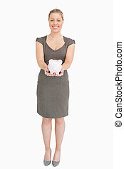 Woman holding a piggy bank