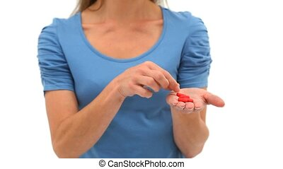 Woman holding a pill