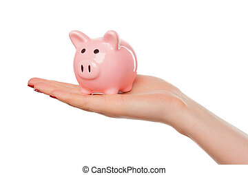 Woman holding a pink piggy bank isolated on white
