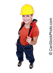 Woman holding a pipe wrench