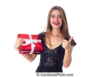 Woman holding a present and showing thumb up