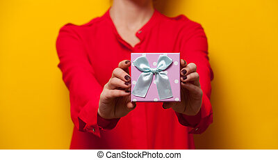 Woman holding a present box