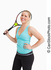 Woman holding a racquet behind her head