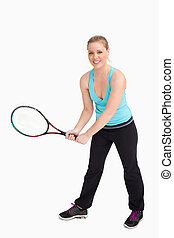 Woman holding a racquet with her two hands