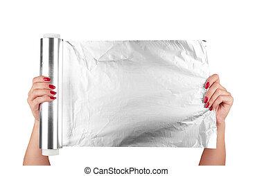 aluminum foil - woman holding a roll of aluminum foil