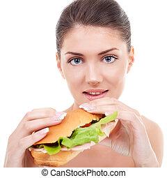 woman holding a sandwich