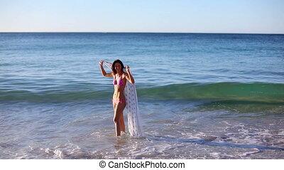 Woman holding a sarong