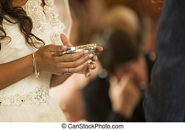 Woman holding a Scottish Quaich during wedding ceremony -...