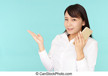 Woman holding a smart phone