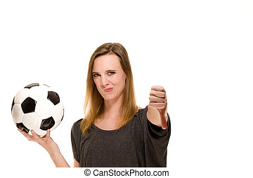 woman holding a soccer ball showing thumbs down on white background