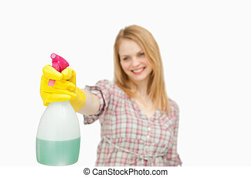Woman holding a spray bottle