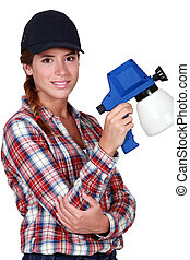 Woman holding a spray gun