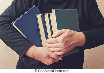 Woman holding a stack of books