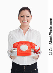 Woman holding a telephone on the tray