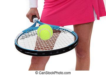woman holding a tennis racket