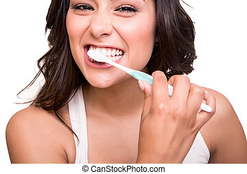 Woman holding a tooth brush - Smiling young woman with...