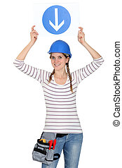 Woman holding a traffic sign