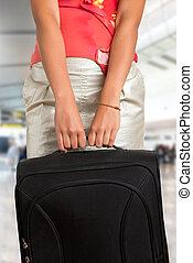 Woman Holding a Travel Bag