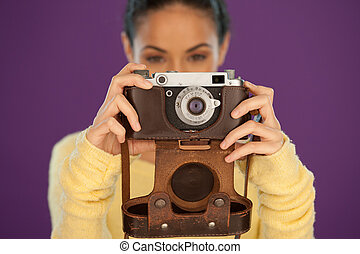 Woman holding a vintage film camera