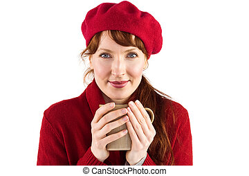 Woman holding a warm cup
