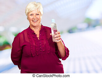 Woman Holding A Water Bottle