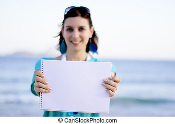 woman holding a white board