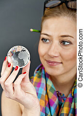 woman holding a world ball