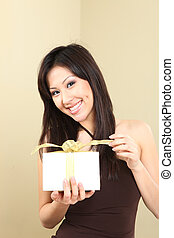 Woman Holding a Wrapped Gift Package