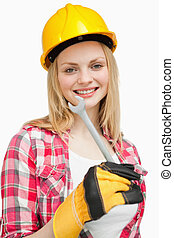 Woman holding a wrench while standing