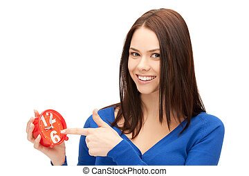 woman holding alarm clock - bright picture of woman holding...