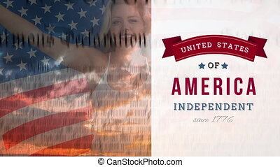 Woman holding American flag with constitution and independent banner