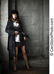 Woman holding an assault rifle