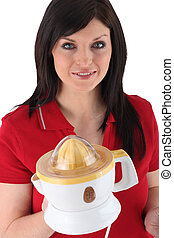 Woman holding an electric lemon squeezer