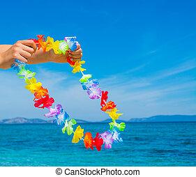 Woman holding an Hawaiian necklace