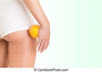 Woman Holding an Orange Against Her Thighs