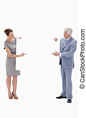Woman holding and pointing to a big white sign with a white hair businessman against white background