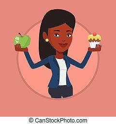 Woman choosing between apple and cupcake.