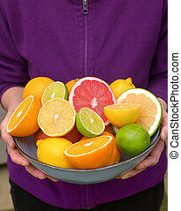 Woman Holding Assorted Citrus Fruit - Woman Hands Holding ...