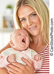 woman holding baby girl
