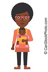 Woman holding baby in sling. - An african-american woman...