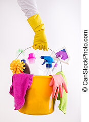 Woman holding basket with cleaning products - Close up of...