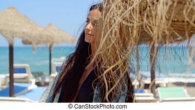 Woman Holding Beach Umbrella Looking Into Distance -...