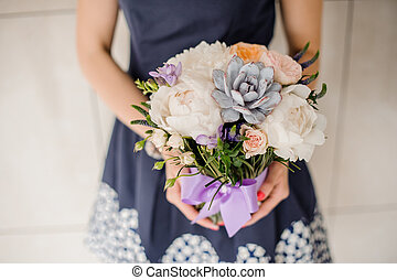 Woman holding beautiful floral bouquet no face - Woman...