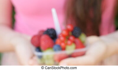 Woman holding berries and fruit in hands