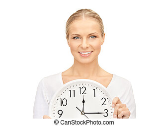 woman holding big clock - picture of woman holding big clock...